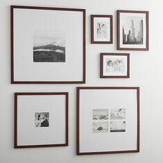 Classic brown wood and extra-wide white mat frames in a modern, gallery-style presentation. Stairway Gallery Wall, Gallery Wall Layout, Gallery Wall Frames, Frames On Wall, Framed Wall Art, Gallery Frame Set, Frames Decor, 5x7 Frames, Wooden Frames