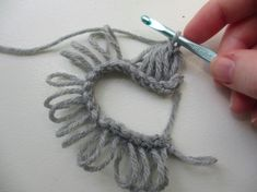 #6. Step 7: Yarn over and pull through all 5 loops. Ch 1 for your turning chain......  See the middle of the 5 loop group? It sort of looks like the eye of a tornado.