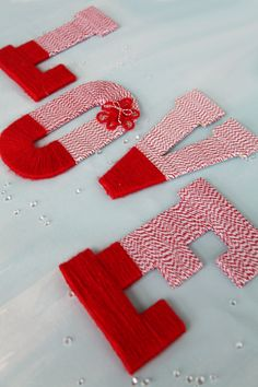 Learn how to make these LOVE twine and yarn wrapped letters for your wedding with this simple step-by-step tutorial!