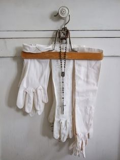 Gloves and wooden hangers. A way to hang your family treasures on the wall.