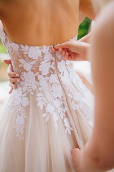 Blush wedding gown with floral accents | Photography: Anna Roussos