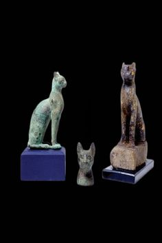 Cats were very important to the ancient Egyptians and were even considered to be demi-deities. Not only did they protect the crops and slow the spread of disease by killing rodents, they were also thought to be the physical form of the goddess Bastet. Bastet was the goddess of protection, pleasure, and the bringer of good health. She had the head of a cat and a slender female body. Cats In Ancient Egypt, Deities, Female Bodies, Witch, Lion Sculpture, Museum, Egyptians, Statue, Explore
