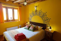 This deluxe double room with private bath is located in Casa Tara at Suryalila Yoga Retreat Centre in Villamartin, Spain.  It has a window which looks onto the charming Plaza de las Naranjas. It is on the ground floor with its own private bathroom and is available for an individual or a couple. It includes the use of  Casa Kali's living room, dining area, kitchen and outside patio.
