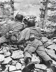 Two US soldiers from an Airborne regiment use a machine gun to cover a road junction from the door of a deserted house during a training excerise in the Venafro sector of the Italian Front, December 18, 1943. Pin by Paolo Marzioli