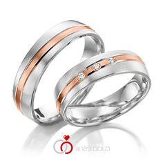 1 Paar Trauringe - Legierung: Weißgold 585/- Rotgold 585/- Breite: 5,50 - Höhe: 1,40 - Steinbesatz: 3 Brillanten zus. 0,06 ct. tw, si (Ring 1 mit Steinbesatz, Ring 2 ohne Steinbesatz)