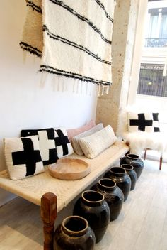 Wall Decor and Pillows - a gorgeous woven blanket and rope woven pillows as accents.