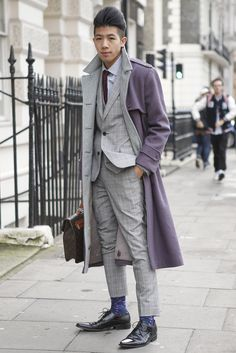 Winter grey tone-on-tone tailoring nicely coordinated with the inside colour of the double-faced overcoat. Street style at London Collections: Men.