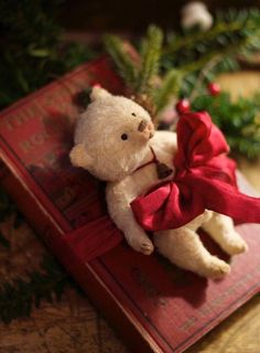 The Spotted Hare Gallery:A wee teddy of vintage rayon tops an antique child's book ~ Titled:The Story of the White Rocking Horse Victorian Christmas, Vintage Christmas, Christmas Crafts, Christmas Decorations, Primitive Christmas, Christmas Teddy Bear, Little Christmas, Green Christmas, Christmas Morning