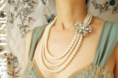 Vintage bridal statement necklace, Vintage rhinestone wedding brooch, wedding jewelry triple strand pearl statement jewelry. $142.50, via Etsy.