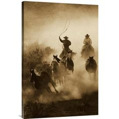 East Urban Home Oregon 'Horses Herded by Cowboy and Cowgirl' Photographic Print on Wrapped Canvas