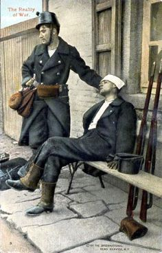 First World War Belgian soldier standing by a wounded comrade