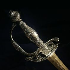 Smallsword in musketeer style, c. 1765. Made by Master J.F. Senckeysen and J.J. Dörfer in Strasbourg Germany. Steel, leather, various fabric, and silver guard and handle.