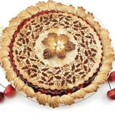 Make a stencil cutout and use a blend of cinnamon & sugar on the top of your pie - gorgeous