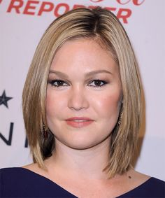 Julia Stiles -This highlighted mane is blow-waved smooth from root to tip to achieve this flat shape best suited to frame a round face.