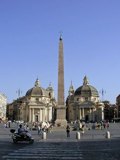 Churches of Santa Maria di Montesanto & Santa Maria dei Miracoli on Piazza del Popolo. The beginning of Via del Corso is hidden behind the Flaminian Obelisk in the center.