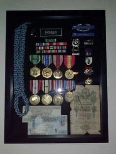 Military Awards Display.   16x20x1 3/4 shawdow box at Hobbylobby for $39. Custom cases are easily over $100 for these.