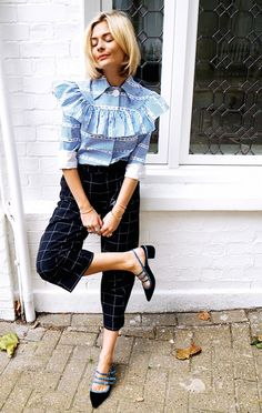 Pandora Sykes wears a striped ruffle blouse with checkered cropped trousers.