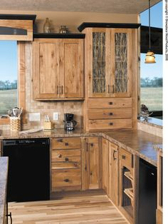 Dark trimmed Hickory Cabinets... just what Derek is doing in our kitchen!