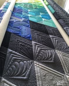 Like the simple triangles with lines going two directions for Pegs quilts.