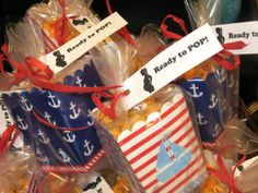 Ahoy, it's a BOY! Nautical Themed Shower. Post includes recipes and links to nautical themed accessories used at the baby shower. Popcorn baby shower favors.