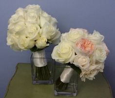 All white rose bride bouquet and the maid of honor ' mixed rose bouquet