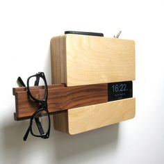 """""""The Butler is made to fit your wallet and keys in the top sleeve, your iPhone on the side slot with a concealed space for your charging cord, and glasses/hat/scarf, (or other go-to item,) on the slide out walnut piece. The backside includes a routed out section for your charging cord and extension cord."""" - Curtis Micklish"""