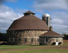The Annala Round Barn in Iron County is one of Wisconsin's most distinctive rural buildings. Photo by Joe Jopek 12248 N DuPont Rd Town of Oma. Stone Barns, Stone Houses, Farm Barn, Old Farm, Wisconsin, American Barn, Barn Pictures, Country Barns, Country Living