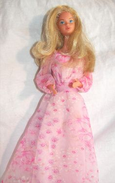 Kissing Barbie - she had a special lipstick and you pressed a button on her back and she made a kissing sound. She kissed Ken A LOT!*