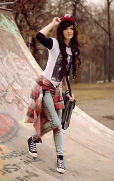 Skater plaid. Her style is probably really catchy and easy to create since it a comfy style