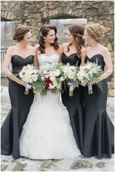 Elegant bridesmaids in black   Cambridge Mill Winter Wedding by Jenn Kavanagh Photography