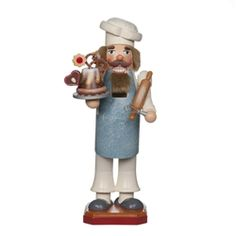 Baker Nutcracker, Christmas Baker with his finest cake. Each nutcracker in this series has a numbered brass plate under the base.