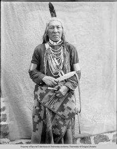 A Cayuse Man Wearing a Pendleton Blanket. Credit: Photograph by Lee Moorhouse. Courtesy University of Oregon Libraries.
