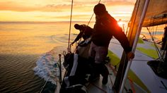 May 20, 2015. Leg 7 to Lisbon onboard Team Brunel. Day 03. Rokas Milevicius and Jens Dolmer stacking under the sunset. Lack of breeze for Team Brunel brought the fleet back together. Rokas Milevicius grips the daggerboard with his hands because the stack is so heavy Stefan Coppers / Team Brunel / Volvo Ocean Race