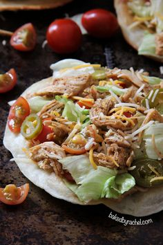 Loaded seasoned chicken tacos on a puffy fried tortilla. Recipe by @Rachel {Baked by Rachel}