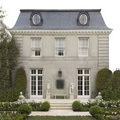 French countryside maison.  French Country house exterior, masonary, white windows, terrace, simple landscaping boxwood beautiful.