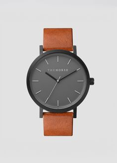 Matte Black & Tan Leather Watch / THEHORSE A simple take on the classic time-teller. Featuring a sandblasted, matte-black stainless steel case, with cool grey face, minimalist markers and premium tan. Matte Black, Black And Grey, Horse Watch, Ring Verlobung, Stainless Steel Case, Quartz Watch, Fashion Watches, Tan Leather, Watches For Men