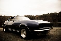 67 camaro. That's my car. Oh how I long to cruise around in thee again. Gotta get the hubby to work on that!