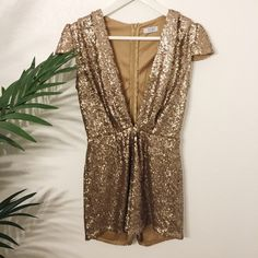 Tobi Gold Sequin Romper Accentuate your summer tan with Tobi's gorgeous gold sequin romper ☀️ Features a plunging neckline + a snug fit ⚜ It's never been worn so the romper is in perfect condition!  Tobi Dresses Mini