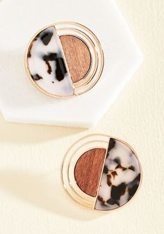 You'll really be a high roller of haute style with these deco earrings luxe-ing up your lobes! Tortoiseshell hemispheres accompany copper curves and wooden accents, offering a mixed media marvel that'll leave you stylishly satisfied.