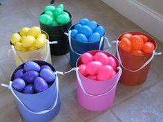 "Color coordinated Easter egg hunt. You can only collect your color of egg. Stops one kid from getting all the eggs!  Also love the DIY painted tin can ""baskets""."