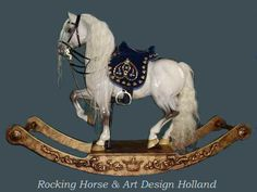 Giovanni The horse is made of limewood and we spent over 400 man-hours to create and finish it. The removable saddle with a wooden tree is covered with royal blue velvet with a light blue (suede leather) lining. Embroidery with gold, light blue, some red, silver silk and brass decorations in the model of hearts for the finishing 'touch'. The dark blue bridle and martingale is also hand made for this horse and covered  covered with brass decorations. Rocking Horse & Art Design Holland