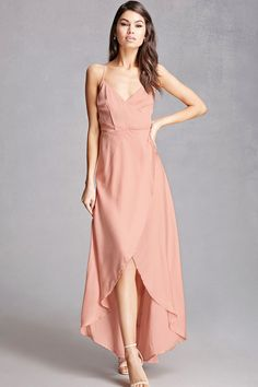 A satin maxi dress featuring a surplice front, cami straps, an asymmetrical wrap front, a concealed back zipper, an attached belt, and a high-low hem. This is an independent brand and not a Forever 21 branded item.