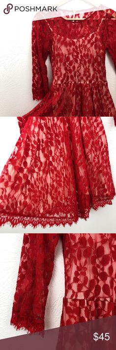 "Free People Floral Lace Overlay Dress Red floral mesh and lace dress. 3/4 length sleeves. Built in slip. Hidden side zipper. No snags, holes, tears, or any sign of wear. Lace is a cotton/nylon blend and slip is rayon. Approximately 31"" bust, 35"" long. 13.5"" waist, 17.5"" sleeves.  Excellent condition.  (C07) Free People Dresses Mini"