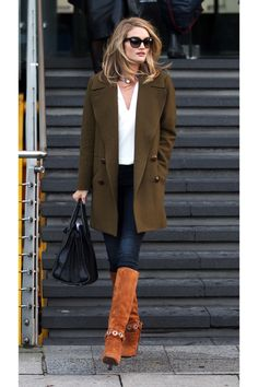 Who: Rosie Huntington-Whiteley What: A Suede Knee-High Boot Why: The always-in-style star stepped out in a fetching green military-inspired coat paired with ultra-luxe suede boot for a modern take on '70s jetset. Get the look now: Michael Michael Kors boots, $275, zappos.com.   - HarpersBAZAAR.com
