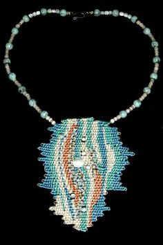 """Tequila Sunrise"" - 2012 - Fixed Length Choker, asymmetrical design, mother of pearl beads woven in, SOLD.  Woven by Terri Scache Harris, theravenscache.shutterfly.com   Hand woven, handwoven, weaving, weave, needleweaving, pin weaving, woven necklace, fashion necklace, wearable art, fiber art."