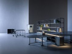 New Modular Office Desk Range designed by Gensler Architects. The range includes a mobile desk, matching office shelving & standing tables.