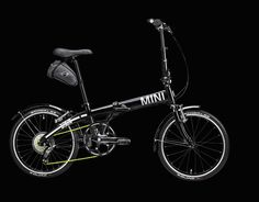 Enjoy the ride in this MINI Cooper Folding Bike, built for exploring the city. Offers the ultimate in flexible transportation with its lightweight aluminum frame and matte black finish. Weighs just 24 pounds!