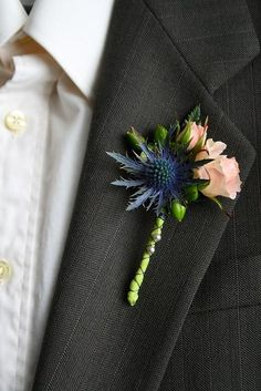 This website has a lot of boutonnieres with blue thistles.