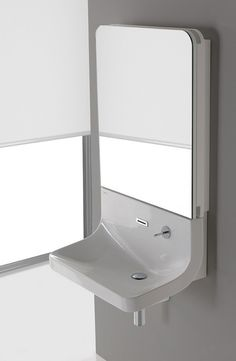 Ultra-modern in looks and ultra-functional by design, this cool sink mirror combo by Sanindusa is as much a statement piece as it is a bathroom essential. The aptly named Blend washbasin-and-mirror combo boasts clean, minimalist lines that lead the eye from top to bottom, with simple straight edges and few adornments.