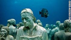 "Cancun, Mexico: Museum of Underwater Modern Art, one of the world's ""weirdest"" places to scuba dive - I agree. Sculptures are made with a cement mix that encourages coral growth!"